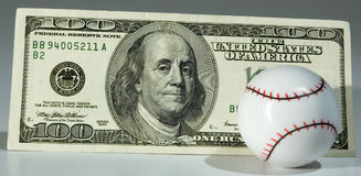 Baseball & $100.00 Fotografie Stock