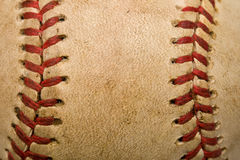 Baseball background. Closeup of old baseball with red stitching for background Royalty Free Stock Images