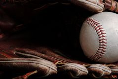 Baseball background. Close up of a baseball glove and ball Stock Photo