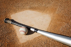 Baseball Background. A baseball and a bat on home plate. Great sports background Stock Photography