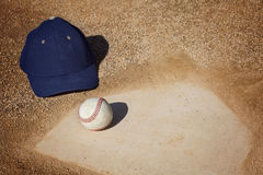 Baseball Background. A baseball and a hat sitting on home plate. Great sports background with room for copy Stock Images