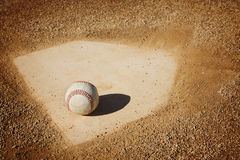 Baseball Background. A baseball sitting on home plate. Great sports background Stock Images