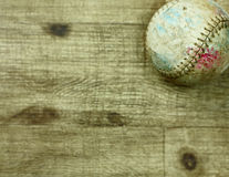 Baseball Background Board. A gritty old vintage baseball on a wood background.  A great background or template display to post your favorite baseball or softball Royalty Free Stock Photo