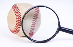 Baseball ball. With Magnifying Glass Royalty Free Stock Photography