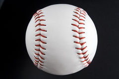 Baseball ball. A close-up of a white baseball ball stock images