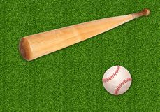Baseball ball and bat on green grass background Royalty Free Stock Images