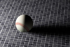 Baseball ball. 3d rendering of a  baseball ball on an old tiles floor Royalty Free Stock Photo
