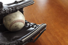 Baseball ball and glove Royalty Free Stock Images