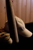 Baseball, ball glove and bat. A baseball bat with a glove and a ball and a cap Stock Photo