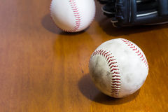Baseball ball and glove. They are two of baseball ball and glove Stock Photography