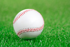 Baseball ball on a green grass. Background stock images