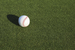 Baseball ball and the ground Stock Images