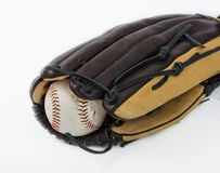Baseball ball inside a glove Royalty Free Stock Images