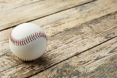 Baseball ball on old rustic wooden backstage Royalty Free Stock Photos
