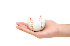 Baseball ball in palm. On white stock photography