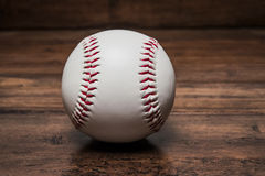 Baseball ball on the table stock images