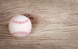 Baseball. Ball on wood background Royalty Free Stock Images