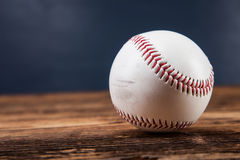 Baseball ball on wooden table Royalty Free Stock Images