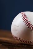 Baseball ball on wooden table Royalty Free Stock Photo