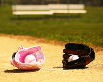 Baseball. Balls in Gloves on Field. Female vs Male royalty free stock photography