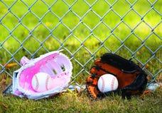 Baseball. Balls in Gloves on Green Grass. Female vs Male stock photos