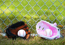 Baseball. Balls in Gloves on Green Grass. Female vs Male Royalty Free Stock Image