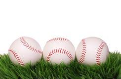 Baseball. Balls on Green Grass Stock Photos
