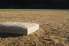 Baseball base. A closeup view of a baseball base in a dirt baseball or softball field Stock Photo