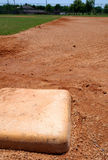 Baseball base bag on infield. A baseball base on a little league field in focus stock images