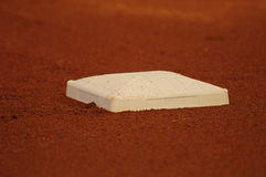 Baseball base on dirt on field Stock Images