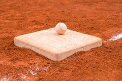 Baseball on a base Stock Photography