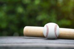 Baseball and baseball bat on wooden table background Stock Photos