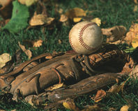 Baseball and baseball glove. A baseball and baseball glove royalty free stock photo