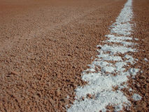 Baseball Baseline. A chalked line between bases on a baseball infield Royalty Free Stock Photo