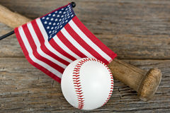 Baseball with bat and American flag Stock Images