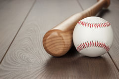Baseball bat and ball. Closeup of baseball bat and ball on wooden table with copy space royalty free stock image