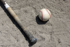 Baseball bat and ball in dirt Stock Image