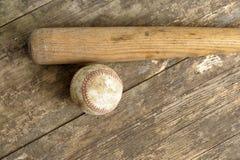 Baseball bat and ball on old grunge floor