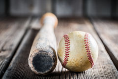 Baseball bat and ball. On old wooden table Stock Photography