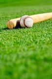 Baseball and bat in field Stock Photos