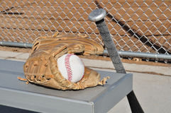 Baseball, Bat, and Glove. On an Aluminum Bench Royalty Free Stock Images