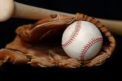 Baseball and Bat and Glove on black Stock Photos
