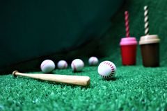 Baseball and bat on the green grass stock photos