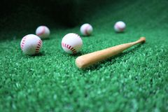 Baseball and bat on the green grass royalty free stock photo