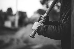 Baseball bat in hands ready to attack Royalty Free Stock Image