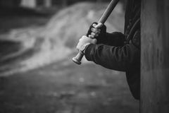 Baseball bat in hands ready to attack. Aggressive hooligan with the baseball bat in hands ready to attack from behind Stock Photos