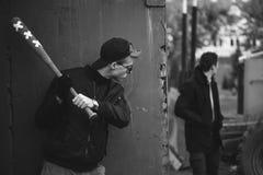 hooligan  ready to attack with baseball bat Stock Photos