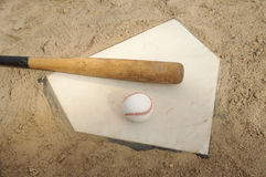 Baseball And Bat On Home Plate Stock Photography