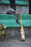 Baseball bat. Leaning against the concrete wall royalty free stock photography