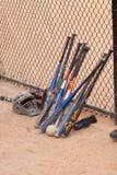 Baseball bats and fence.